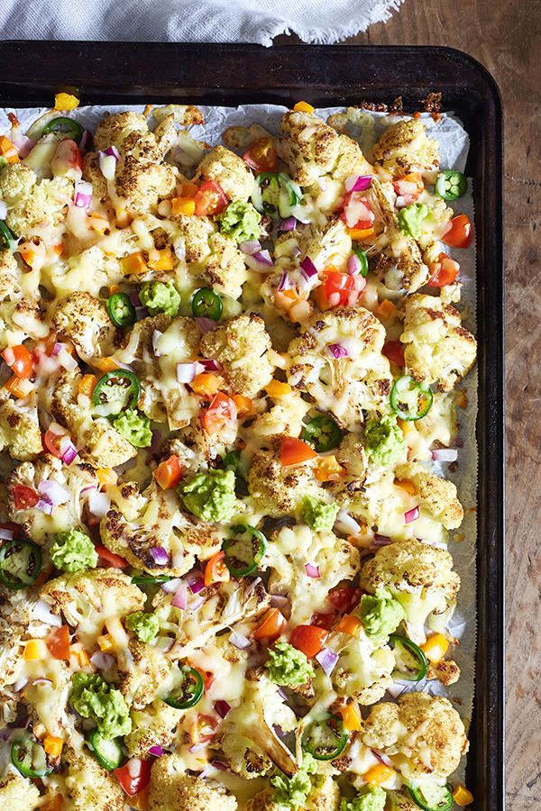 Indulge your craving for nachos any time with this delicious cauliflower nachos recipe that ditches fried tortilla chips for something even tastier. // healthy recipes // snacks // football season // vegetarian // Beachbody // BeachbodyBlog.com
