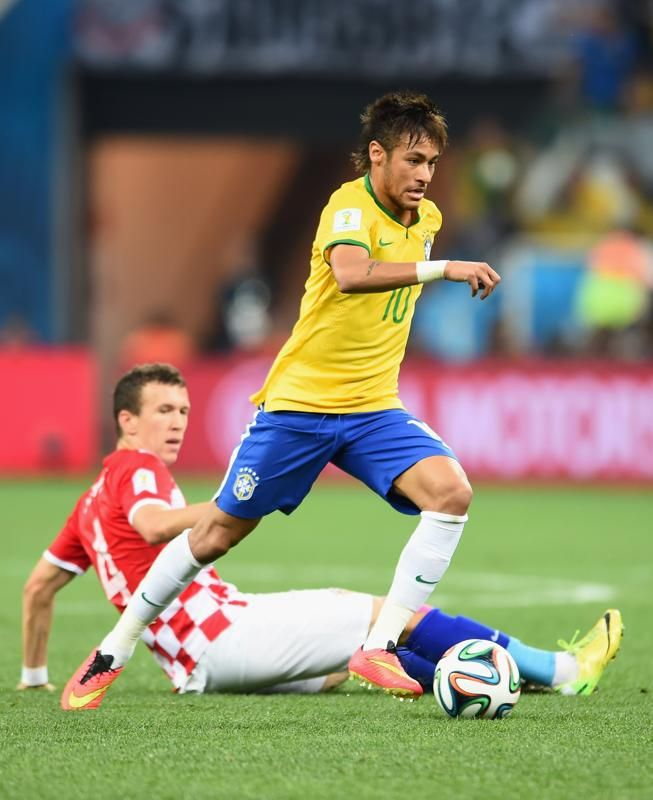 Brazil v Croatia: Group A - 2014 FIFA World Cup Brazil - Neymar of Brazil dribbles past Ivan Perisic of Croatia in the first half during the 2014 FIFA World Cup Brazil Group A match between Brazil and Croatia at Arena de Sao Paulo on June 12, 2014 in Sao Paulo, Brazil. (Photo by Buda Mendes/Getty Images)