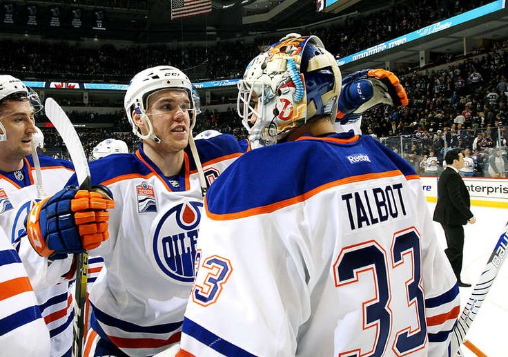WINNIPEG, MB - DECEMBER 1: Connor McDavid #97 of the Edmonton Oilers embraces goaltender Cam Talbot #33 following a 6-3 victory over the Winnipeg Jets at the MTS Centre on December 1, 2016 in Winnipeg, Manitoba, Canada. (Photo by Darcy Finley/NHLI via Getty Images)