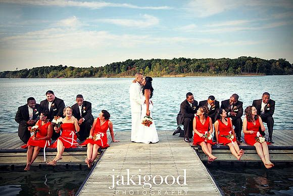 Group Photography Ideas: 20 Creative Wedding Poses for Bridal Party-- 11. Moment in Time: Position the wedding party out while the couple stands in the middle to add drama and visual interest to your image.
