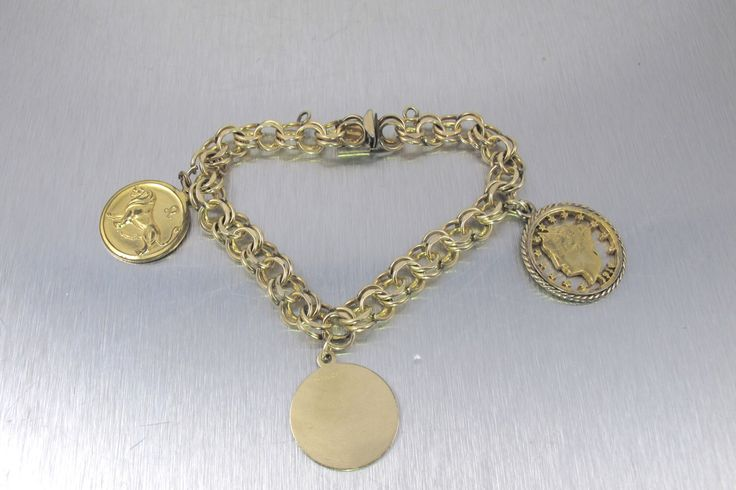 Vintage Charm Bracelet, Jacoby Bender Mid Century Jewelry, Zodiac Leo Lion Astrology Charm, Cut Out Coin Cham, 12K Gold Fill Charm Bracelet by TonettesTreasures on Etsy https://www.etsy.com/listing/254803837/vintage-charm-bracelet-jacoby-bender-mid