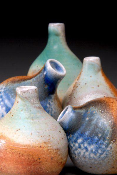 Emily Murphy, 2-3.5 h. Wheel-thrown white stoneware. Sprayed glazes. Soda fired to c. 10 in reduction.