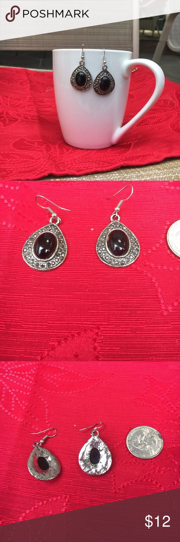 Festive silver tone earrings. Beautiful silver tone earrings with black stones in center and marcasite stones surrounding the large black stones. Shiny, hangs well, no stones missing, in excellent condition. Jewelry Earrings