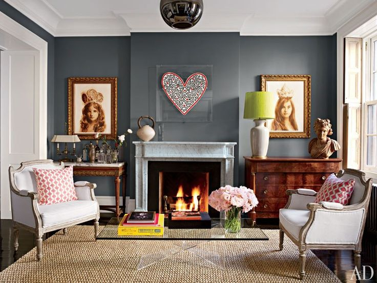 Decorator David Flint Wood painted the living room of actress Brooke Shields's New York townhouse in Benjamin Moore's cozy Chelsea Gray. Portraits of Shields's two daughters flank a heart-shaped Keith Haring work, which was a gift from the artist. (March 2012)