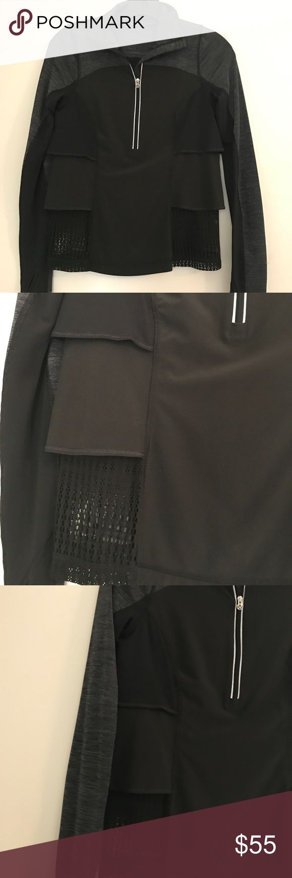 Lululemon 3/4 zip long sleeved top Lululemon black workout top with a 3/4 zip. Grey on sleeves and collar. Cute tiered/ruffle detail on sides with mesh that makes this fun and flattering. Size 2 lululemon athletica Tops