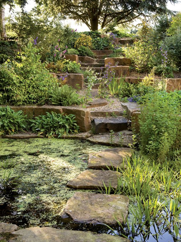 Landscaping Ideas For Sloping Gardens stunning sloping garden landscape designed with grey retaining wall ideas made from stone and concrete flooring Stepping Stone Bridge Landscaping Garden Galleries Hgtv Home Garden Television