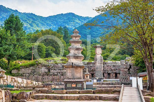 Qdiz Stock Photos | Big Buddha statue with stone monument in Korea,  #antique #architecture #asia #asian #big #Buddha #buddhism #buddhist #culture #day #giant #god #Korea #korean #landmark #monument #national #park #place #religion #religious #sculpture #sky #South #statue #stone #traditional #worship