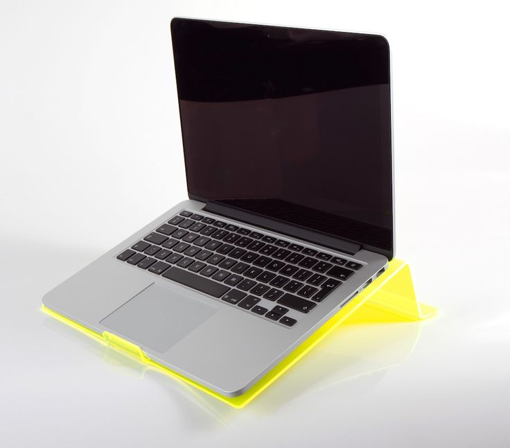 LapStop: Yellow | iStop Shop Ergonomic Support for your laptop, whether at a desk, lying in bed or on the couch, IStopShop has designed a laptop support that STOPS strain on your back, neck and wrists by placing your body in the correct ergonomic position