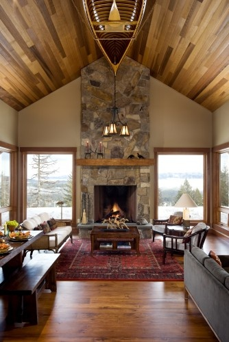 This is the EXACT room, even down to the stone fireplace.  wood trim, floor and ceilings.  Even the wall color is the same.