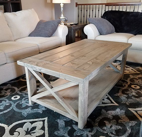 Rustic meets coastal chic with this beautiful solid wood coffee table finished in our exclusive weathered driftwood staining process and coated with a durable matte finish. This piece is versatile and will compliment a variety of color palettes. Measurements: 52 L x 27 1/2 W x 19 1/2 H  We also offer 2 sizes of matching end tables for sale so please check our other available listings.  Custom sizes and finishes are available. Please contact me and Id be happy to discuss other options…