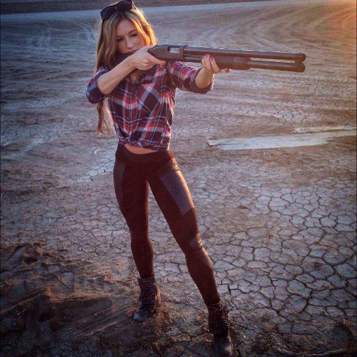 Paige Hathaway shooting a shotgun