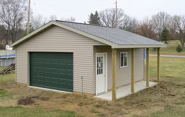 Pole barn garage with porch custom barn the yard for Barnyard garages