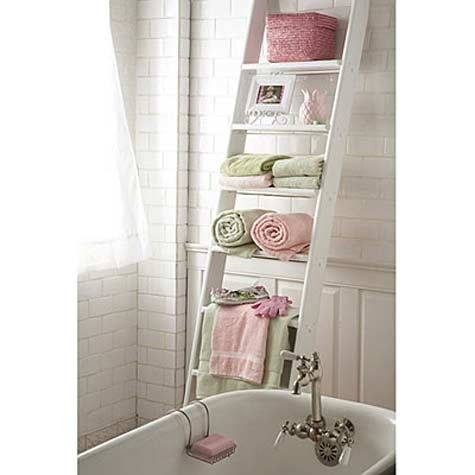 Quick bathroom storage. Paint an old ladder, lean it against a wall, add towels and accessories.