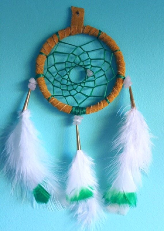 Authentic dreamcatcher with rose quartz chips, and naturally shed feathers by EarthDiverCreations on Etsy https://www.etsy.com/ca/listing/487256953/authentic-dreamcatcher-with-rose-quartz