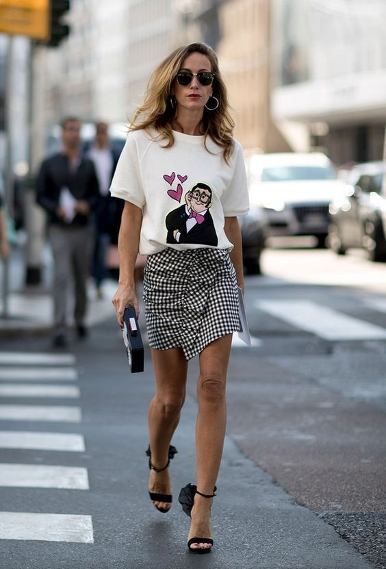 ruffled skirt with a graphic tee and single strap sandals