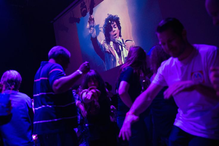The Year in Pictures 2016 - The New York Times - MINNEAPOLIS 4/21/2016 Fans danced below a slideshow of Prince images at a memorial party following the musician's death from an accidental overdose of the painkiller fentanyl.
