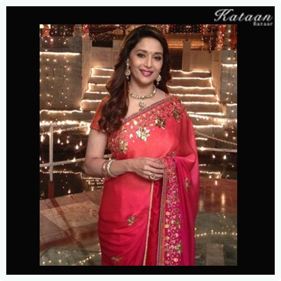 The evergreen beauty #Madhuri Dixit in a simple RED saree