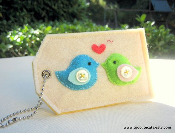 """Cute! A felt luggage tag, gift card holder or reusable gift tags."""