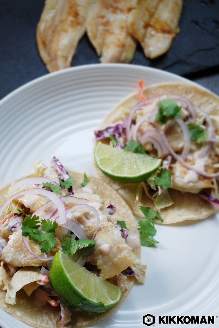 Grilled Fish Tacos with Sriracha   Tacos are here to make life easier and hands messier. All you need is some corn tortilla shells and a little imagination! First, make a fish glaze with Kikkoman®️ Soy Sauce, honey, lime juice, and garlic. Bake the fish in the oven or prepare it on the grill, then serve it in tortillas with coleslaw, red onion, and a touch of cilantro. Finish it all off with a spicy sriracha-yogurt sauce.   Explore more quick recipes at KikkomanUSA.com.