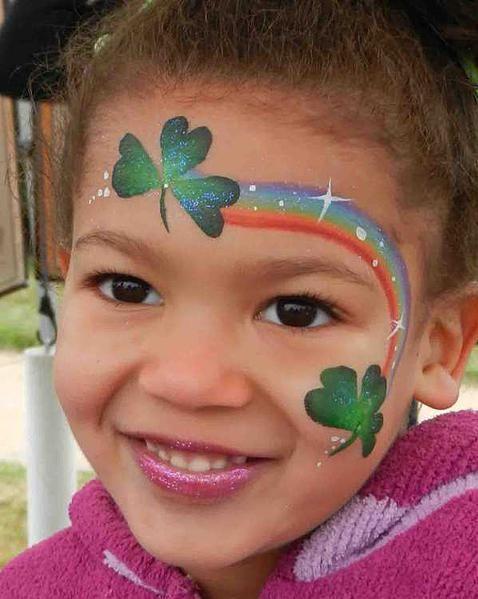 Regenboog schmink - rainbow face painting www.hierishetfeest.com