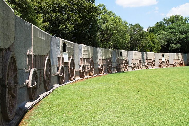 A 'laager' of 64 granite ox-wagons surrounds the main block of the Monument and at the entrance stands a bronze sculpture of a Voortrekker mother and her children created by Anton van Wouw. This was also the last major work by the sculptor