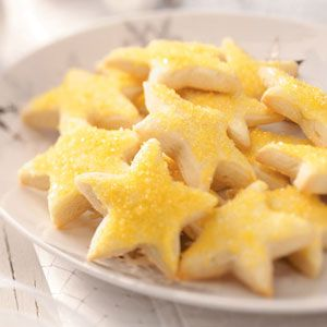Lemon Stars Recipe -Each one of these cookies has a citrusy zing and a light, crunchy texture. The star theme makes them ideal for the Christmas season. —Jacqueline Hill, Sandusky, Ohio