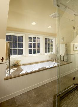 Bathroom shed dormer lets in tons of natural light, and adds extra interior space to create the perfect spot for a nice, big soaking tub.