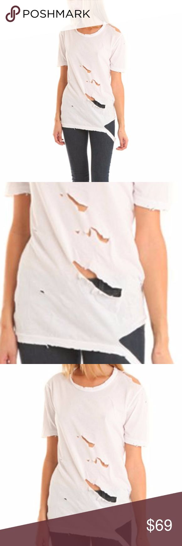 Nightcap Clothing Kylie Jenner Ripped Tee in White Nightcap Clothing Kylie Jenner Ripped Tee in White  Nightcap Clothing Ripped Boyfriend Tee in White The Nightcap Ripped Boyfriend Tee in White is distressed to please. Made from soft cotton jersey, the crew tee features a draped fit. Holes and distressing throughout and ripped hem give the traveler-inspired tee its finishing touch.      Color: White     Fabric: 100% Supima Cotton     Ripped Hem / Distres Nightcap Tops Tees - Short Sleeve