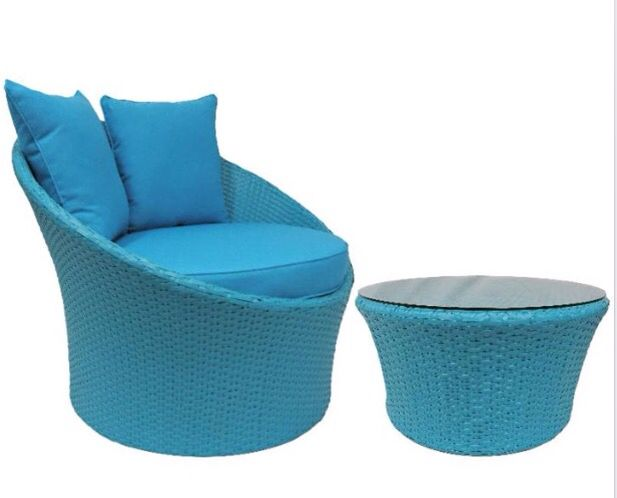 Blue Grace Chair, wicker, ottoman and coffee table.