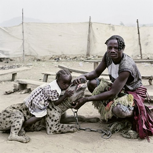father, daughter and hyena