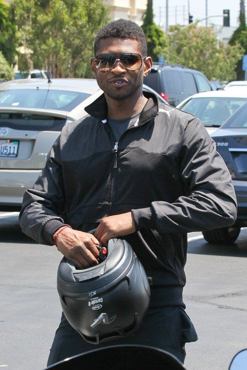 Usher looks like a pop star even on trips to Whole Foods. He picked up his groceries in Cazal shades & a sporty zip-up