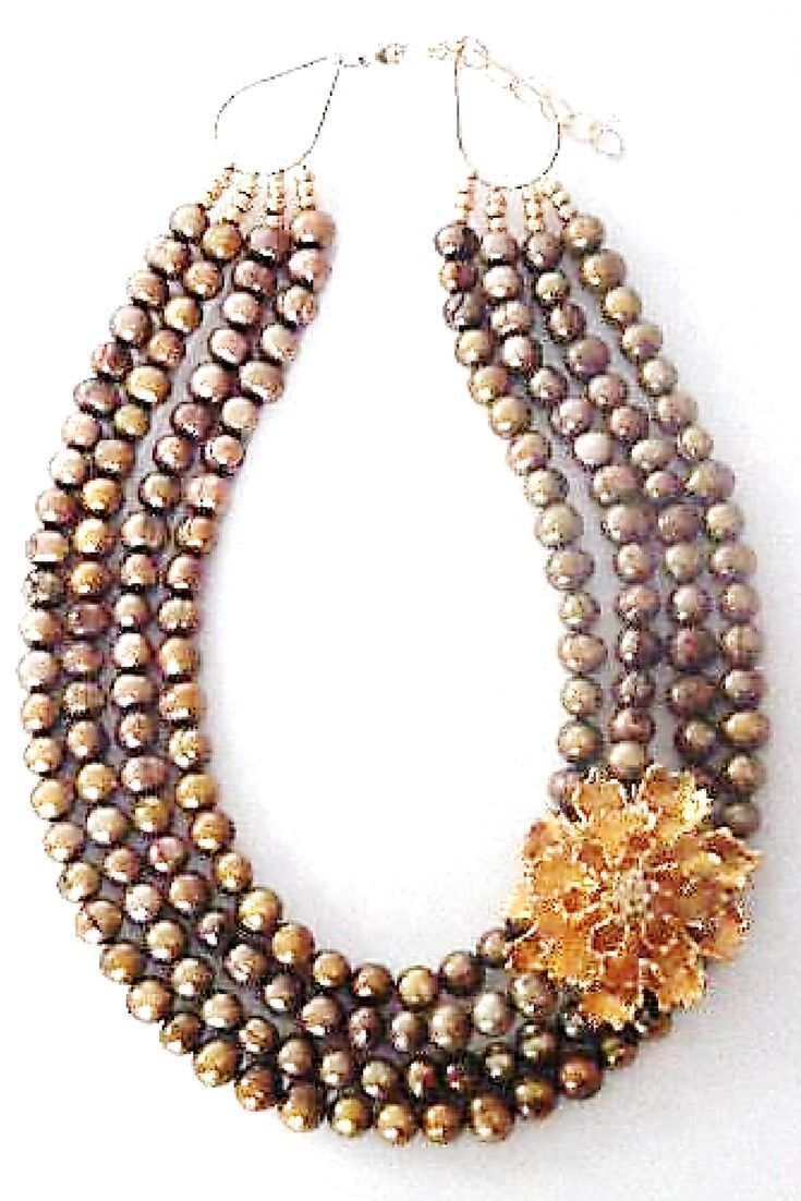 Gold freshwater pearl &Vintage Flower brooch necklace.  One-of-a-kind statement necklace handmade with gold freshwater pearls paired with vintage brooch $280,00. #statementnecklaces#necklaces#freshwaterpearl