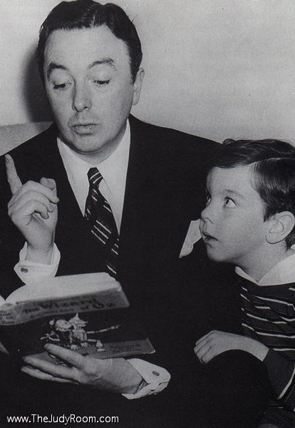 Jack Haley (The Tin Man) reads the Wizard of Oz to his son, Jack Haley Junior.    Jack Haley Jr would go on to marry Judy Garland's daughter, Liza Minnelli