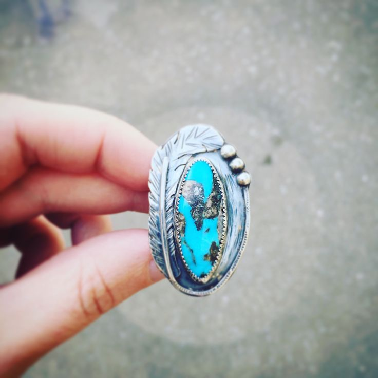 This sterling silver statement ring features natural blue moon turquoise, intense blue with gorgeous brown ...