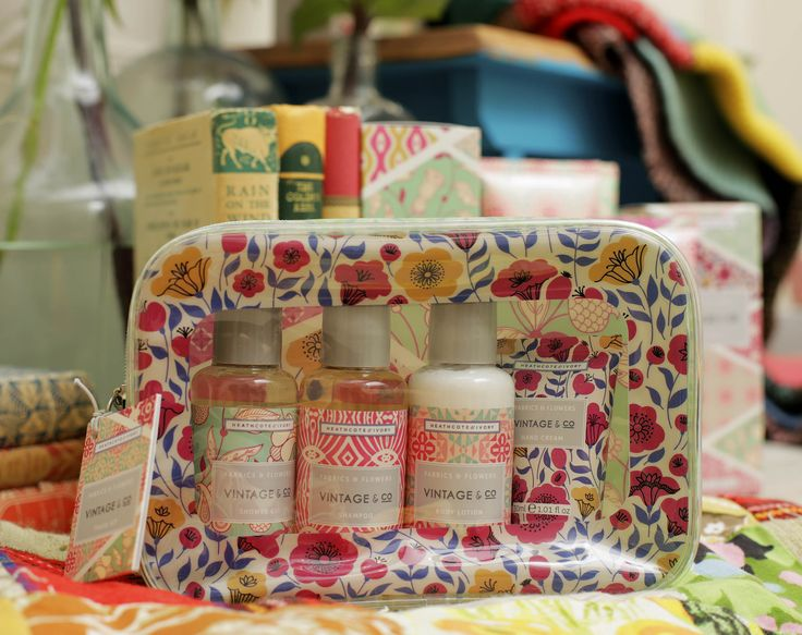 VINTAGE & CO FABRIC AND FLOWERS Everything at the ready for travel by plane or train neatly packed in a wipeable Vintage & Co. kit bag; gentle, cleansing shower gel free from sulfates, glycerin enriched body lotion and hand cream and moisturising shampoo.