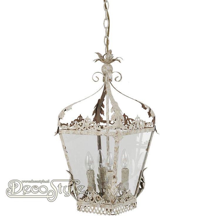 Brocante Hanglamp Seranda Metaal Beige  Metalen brocante hanglamp. De zijkanten voorzien van glas. Met 4x Kleine fitting (E14).   Kleur: Beige natuur tinten.  Afmetingen lamp zonder ketting: Hoogte: 58 cm Breedte: 29 cm Diepte: 29 cm  Hoogte met ketting: +/- 150 cm