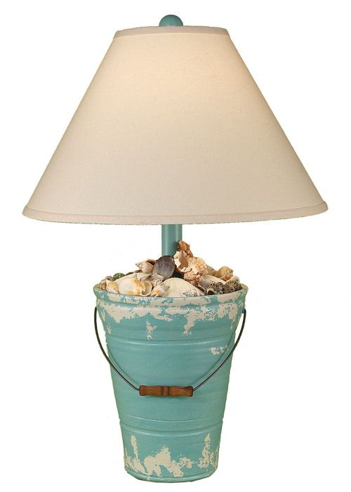 """Enjoy this 27.5"""""""" Bucket of Shells Turquoise beach cottage lamp! Created with a soft distressed turquoise and off-white finish, complete with real seashells decorating the top of the lamp base and met"""