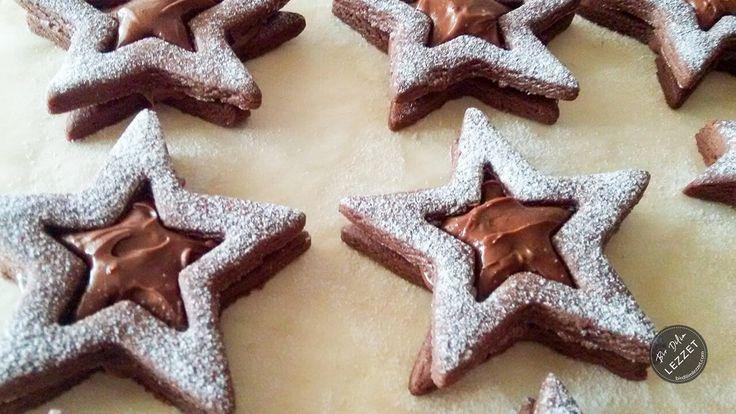 Çikolatalı Yıldız Kurabiye nasıl yapılır? Bir Dilim Lezzet farkıyla denenmiş, resimli ve güvenerek yapabileceğiniz Çikolatalı Yıldız Kurabiye malzemelerine ve tarifine göz atın...