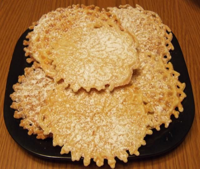 Pizzelles, traditional Italian cookies, are pretty cookies that can be served flat, sandwiched together, made into cones or even into edible bowls. You do need a special iron to make them, but brand new ones can be found online as well as used ones. You won't be sorry if you add pizzelles to your holiday cookie repertoire. They are fun to make and good to eat.