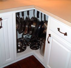 Use the awkward space in corner cabinets to hang pots and pans.   27 Lifehacks For Your Tiny Kitchen