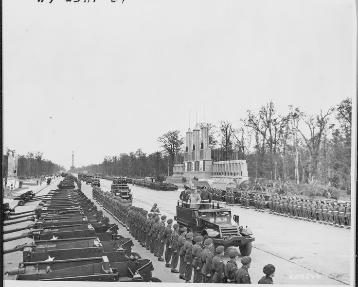 British Prime Minister Winston Churchill passes the parade of Bren carriers belonging to the Canadian contingent during the British Victory parade in Berlin, Germany. Prime Minister Churchill has just arrived to attend the Potsdam Conference.