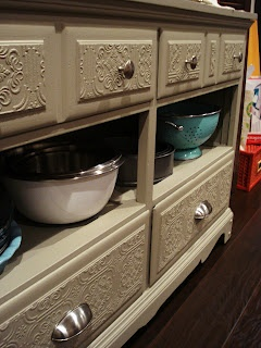 Love this idea! Dresser turned into a buffet table with some paintable wall paper, little bit of paint and some new hardware.  would make a great base for a kitchen island!!