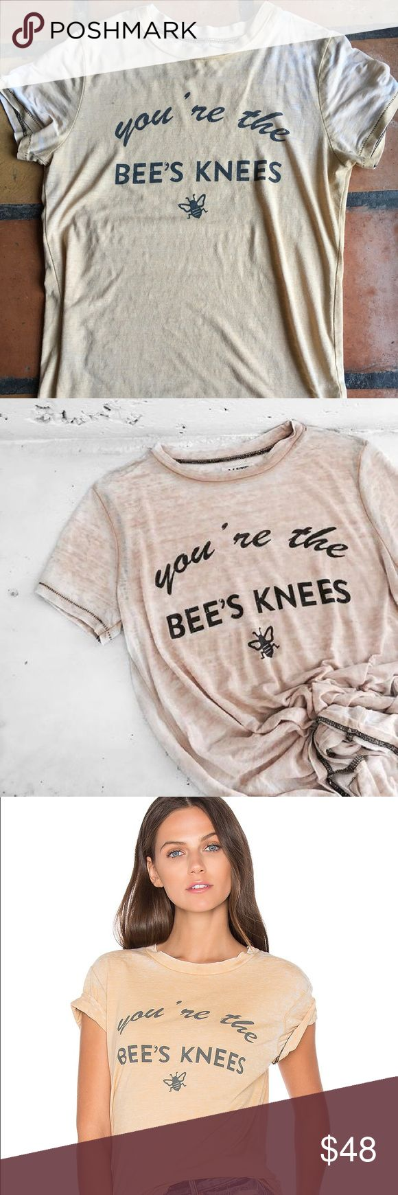 "Mate the Label Bee's Knees Vintage Tee in Small Barely Worn graphic tee from Mate the Label, ""You're the bees knees"". Size is Sm/M. Has an oversized fit. See-through in outer edges of shirt due to its vintage look otherwise no signs of wear. Please see close ups of the fabric for the intentional wear and uneven spots. Looks cute knotted or front tucked. It's a warm mustard color with black stitching. Sold out online!  Label is S/M Length is 26.5"" Pit to pit 17"" Mate the Label Tops Tees…"