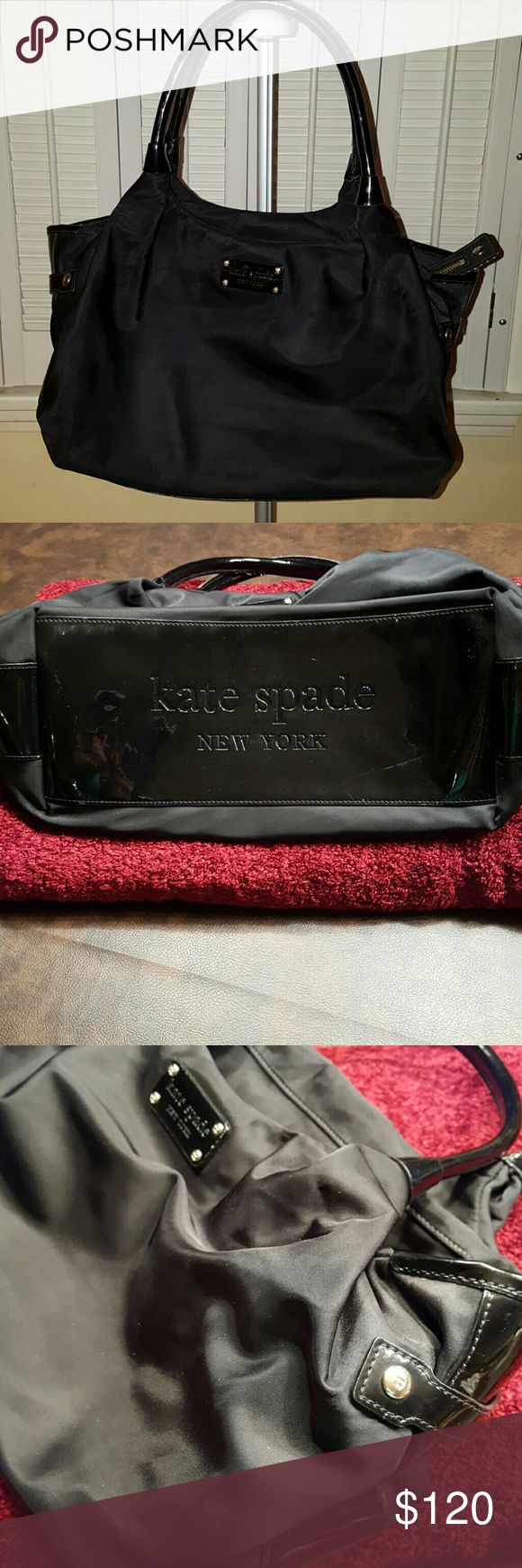 Kate Spade Black Nylon & Patent Shoulder bag Gorgeous, trendy black bag from Kate Spade. Preloved but in great shape.  Nylon with patent leather trim on sides and bottom. Some minor marks on bottom. Pic 2.   Just cleaned professionally inside and out. 16in x 10in. A great everyday bag. kate spade Bags