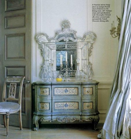 A beautiful corner of the dining room with a French painted chest and beautiful silk taffeta curtains.