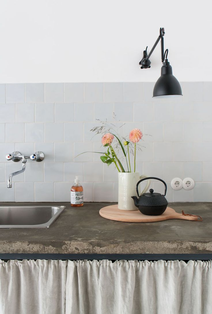 Concrete and linen in the kitchen at Studio Slow