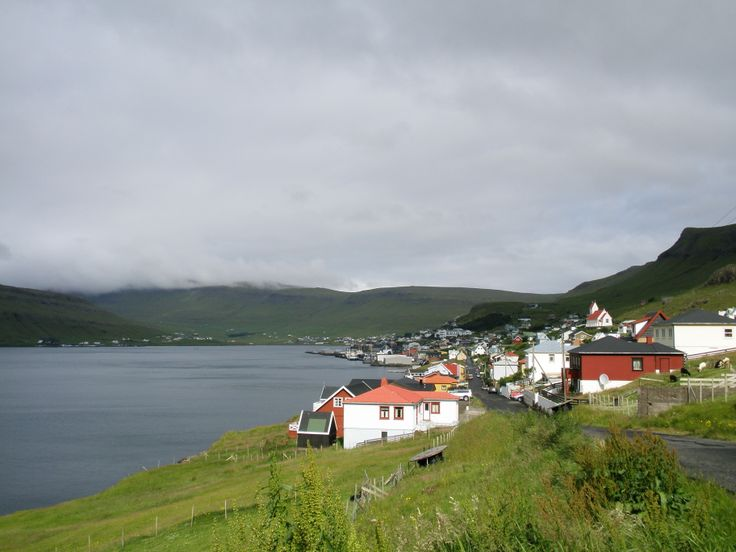 Tvøroyri on the southern island of Suðuroy.  Like many villages and towns in the Faroe Islands it clings to small amount of relatively flat land at the water's edge and is a linear settlement.