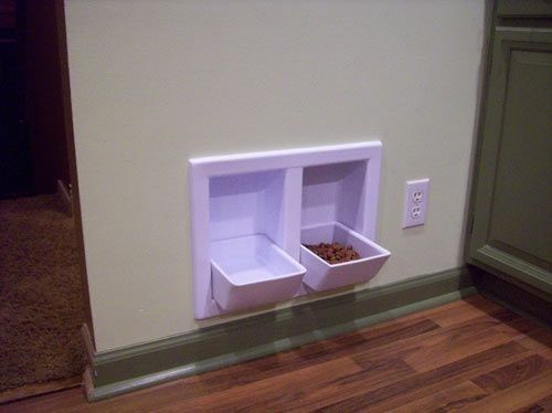 """These """"in the wall"""" pet bowls fold up when not in use to save space."""