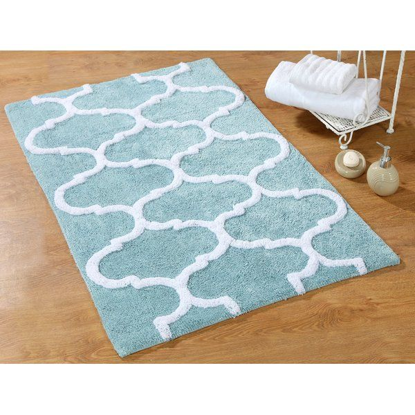 Add a plush touch to the powder room or master bath with this chic cotton mat, featuring a quatrefoil motif for a touch of eye-catching appeal.