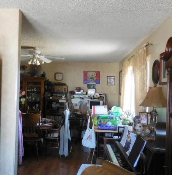 cluttered kitchen dining room bad poor home staging pink hoodie Phoenix Arizona house for sale